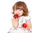 portrait of a little girl eating apples