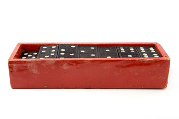 Old red open cardboard dominoes box