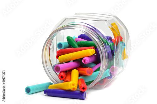 A jar of fountain pen colour refill cartridges