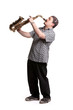 Young caucasian man playing on saxophone isolated on white