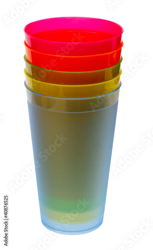 Multicolored plastic glasses for juice isolated on white backgro
