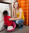 woman loading the washing machine