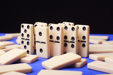 group of figures domino on blue background
