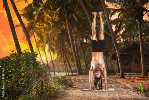 Yoga handstand pose at sunset