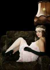 The girl in style 30 on an armchair