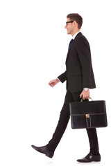 business man holding brief case and walking