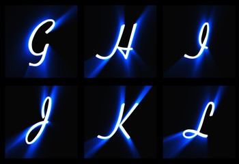 The letters on a black background in blue light