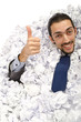 Man with lots of crumpled paper