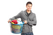 A portrait of a man holding a laundry basket