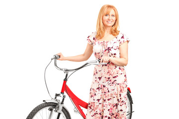 A portrait of a mature female posing next to a bicycle