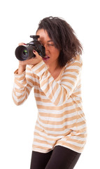 attractive dark skinned girl with a camera on a white background