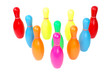 Row of colorful toy plastic bowling pins