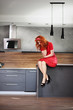 Pensive woman in a kitchen