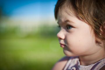 A little girl in a summer park