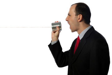 Businessman yelling through an oldschool can phone, horizontal,