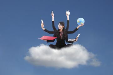 Multi-tasking Business Woman sitting on a cloud