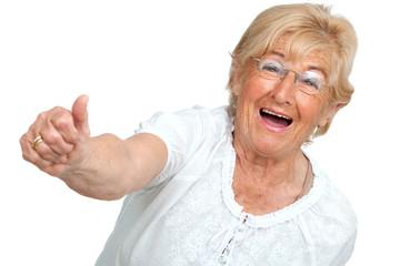 Happy senior woman showing positivity.