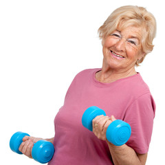 Portrait of senior woman with weights.