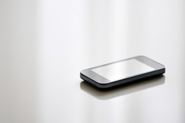 Smart phone on white wooden table