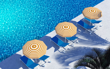 Swimming pool lounge hotel yellow striped umbrellas
