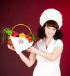 Smiling happy cook woman with vegetables