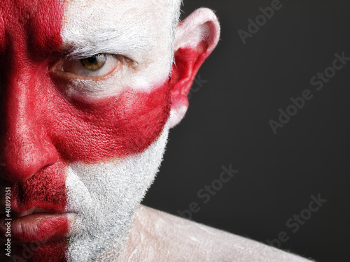 Man with his face painted with the flag of England