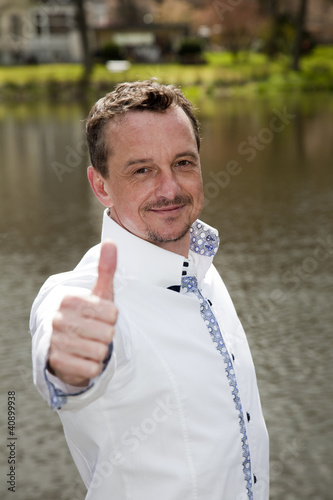 casual man with thumbs up