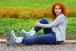 Relaxing ginger girl on skates