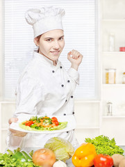chef offering vegetarian meal