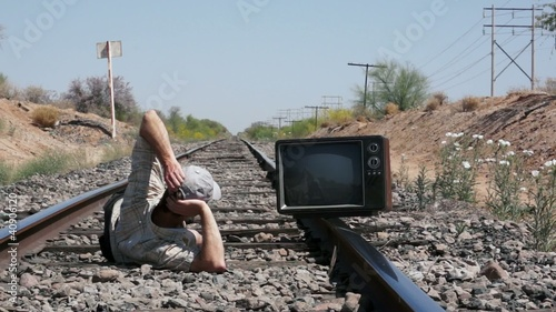 Squatting on the Railway with an Old, Retro TV