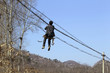 Worker fixing electrical power line, China
