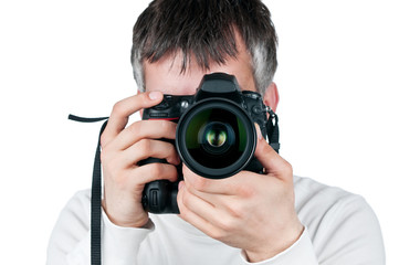 Young man with camera, isolated on white background