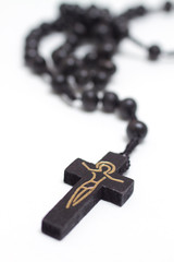 Brown rosary with crucifix - isolated