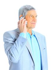 Nice businessman at the age of talking on the phone