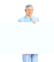 Nice businessman at the age holds white poster.