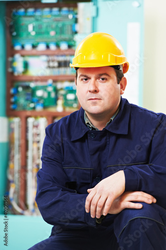 Electrician portrait over distribution power box
