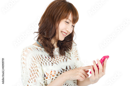 Beautiful young woman using smart phone. Portrait of asian woman