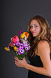 Springtime: Young beautiful woman with black dress an flowers