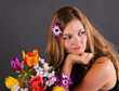 It's springtime: serious-looking, young woman with flowers