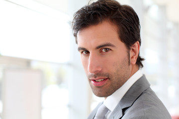Confident businessman looking at camera