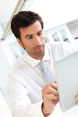 Businessman working on electronic tablet