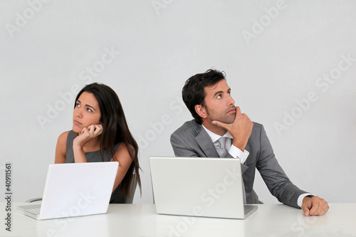 Business team with puzzled look