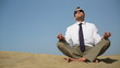 Businessman sitting on the beach and meditating