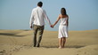 Young couple standing in the desert