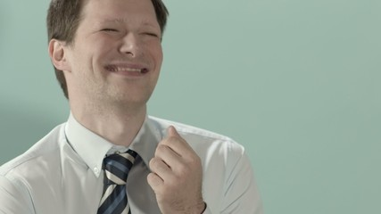 Happy businessman laughing and enjoying good news. Copy space