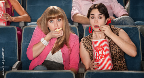Amazed Women Eating Popcorn