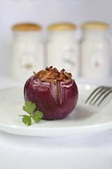 baked onion with bacon and parsley