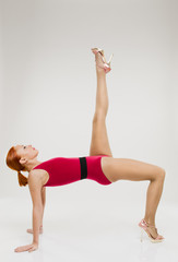 Beautiful fitness woman performing handstand