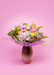 bunch of flowers on pink background