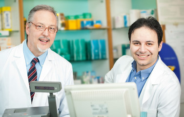 Portrait of two chemists in a drug store